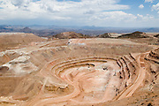 Originally owned by Phelps Dodge, the current Freeport-McCaron copper mine in Morenci Arizona has been around for over 100 years. The copper mine was recently sold to Freeport-McCaron. The mine can be over a mile deep and is curretly over 5 mile wide in some areas.