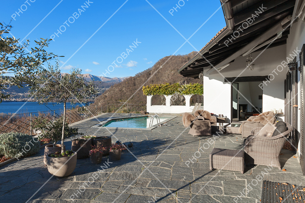 beautiful terrace with pool of a villa, lake view