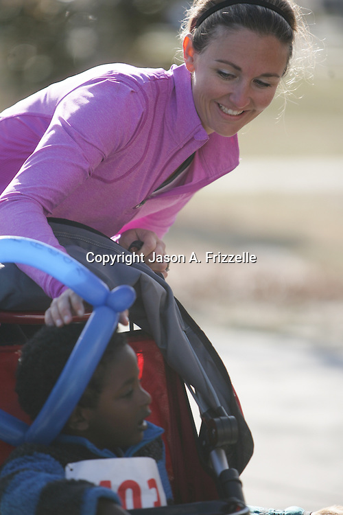 Meredith McCumbee laughs with Aaron McCumbee,4, during the Paws for People 5K. (Jason A. Frizzelle)