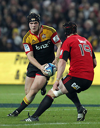 Chiefs' Sam Cane is challenged by Crusaders' Matt Todd in a Super Rugby match, Waikato Stadium, Hamilton, New Zealand, Friday, July 06, 2012.  Credit:SNPA / David Rowland