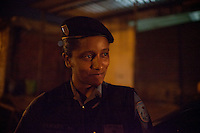 Pacification Police Unit (UPP) officer Tamara Hervano, 28, patrols Complexo do Caju, a complex of favelas in the north zone, Rio de Janeiro, Brazil, on Friday, May 4, 2013.<br /> <br /> In the early hours of Sunday, March 3, 2013, about 1,400 Brazilian security forces occupied 13 communities during a joint public security operation to install a Pacifying Police Unit (UPP) in two Rio de Janeiro favelas, Complexo do Caju and Barreira do Vasco. Elite police units backed by armored military vehicles and helicopters invaded the neighborhood in an on-going policing program aimed to drive violent and heavily armed drug gangs out of Rio's poor communities, where the traffickers have ruled for decades. For the community of Caju, that is ADA (Amigos de Amigos) and CV (Comando Vermelho).