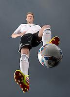 FUSSBALL   INTERNATIONAL  SAISON 2011/2012     Andre SCHUERRLE (Deutschland) posiert im exklusiven Pressefoto ULMER Shooting im neuen Nationaltrikot