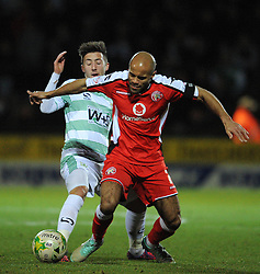 Walsall's Adam Chambers is tackled by Yeovil Town's Josh Sheenan  - Photo mandatory by-line: Harry Trump/JMP - Mobile: 07966 386802 - 03/03/15 - SPORT - Football - Sky Bet League One - Yeovil v Walsall - Huish Park, Yeovil, England.