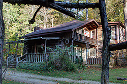 07 October 2013: Creekside Cabin - a cabin built with timbers from an 1860's cabin.  The cabin was rebuilt in 1988.  Two bathrooms, 2 bedrooms + a bunkhouse bedroom, kitchen, living area, gas burning stove and a hot tub are included in the accommodations.  The site is semi-secluded.<br /> <br /> This image was produced in part utilizing High Dynamic Range (HDR) processes.  It should not be used editorially without being listed as an illustration or with a disclaimer.  It may or may not be an accurate representation of the scene as originally photographed and the finished image is the creation of the photographer.
