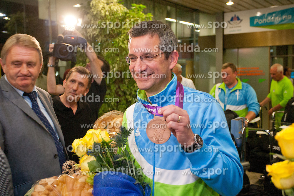 Rajmond Debevec during reception of Slovenian Olympic team, on August 7, 2012 in Airport Joze Pucnik, Brnik, Slovenia.  (Photo by Matic Klansek Velej / Sportida)