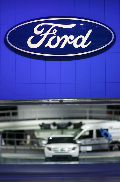 GR --- Detroit, Michigan ---11-01-10--- The Ford logo on display at the company's booth at the North American International Auto Show in Detroit, Michigan January 10, 2011.<br /> Geoff Robins AFP
