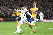 Son Heung-Min of Tottenham Hotspur (7) with a shot on goal during the Champions League match between Tottenham Hotspur and Juventus FC at Wembley Stadium, London, England on 7 March 2018. Picture by Matthew Redman.