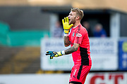 Dundee goalkeeper Scott Bain (#1) shouts instructions to his defenders ahead of a Dundee United free kick during the Betfred Scottish Cup match between Dundee and Dundee United at Dens Park, Dundee, Scotland on 9 August 2017. Photo by Craig Doyle.