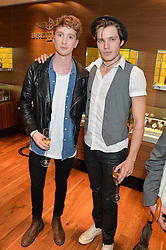 Left to right, actors LUKE NEWBERRY and DOMINIC SHERWOOD at a party to celebrate the 30th Anniversary of the Breitling Chronomat held at 130 Breitling, New Bond Street, London on 7th May 2014.