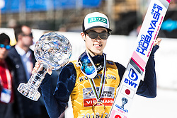 Winner Ryoyu Kobayashi (JPN) in Overall classification kissing a globe at trophy ceremony after the Ski Flying Hill Individual Competition at Day 4 of FIS Ski Jumping World Cup Final 2019, on March 24, 2019 in Planica, Slovenia. Photo by Peter Podobnik / Sportida