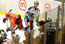 Kuralt Anze of Jesenice and Baumgartner Gregor of Linz during ice-hockey match between HK Acroni Jesenice and EHC Liwest Black Wings Linz in 43rd Round of EBEL league, on Januar 17, 2012 at Dvorana Podmezaklja, Jesenice, Slovenia. (Photo By Urban Urbanc / Sportida)