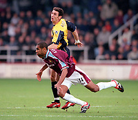 Frederic Kanoute (West Ham) falls under the challenge of Martin Keown (Arsenal). West Ham United 1:2 Arsenal. FA Premiership, 21/10/2000. Credit: Colorsport.