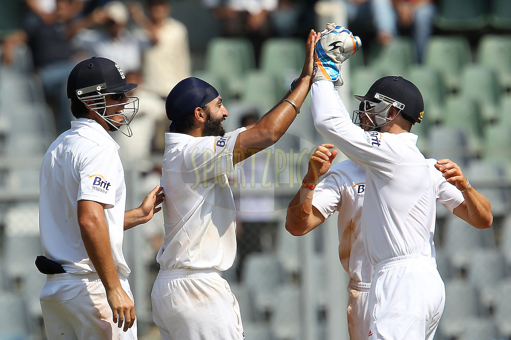 Monty Panesar of England celebrates the wicket of Virat Kohli of India during day 1 of the 2nd Airtel Test match between India and England held at the Wankhede Stadium in Mumbai, India on the 23rd November 2012...Photo by Ron Gaunt/ BCCI/ SPORTZPICS..Use of this image is subject to the terms and conditions as outlined by the BCCI. These terms can be found by following this link:..http://www.sportzpics.co.za/image/I0000SoRagM2cIEc