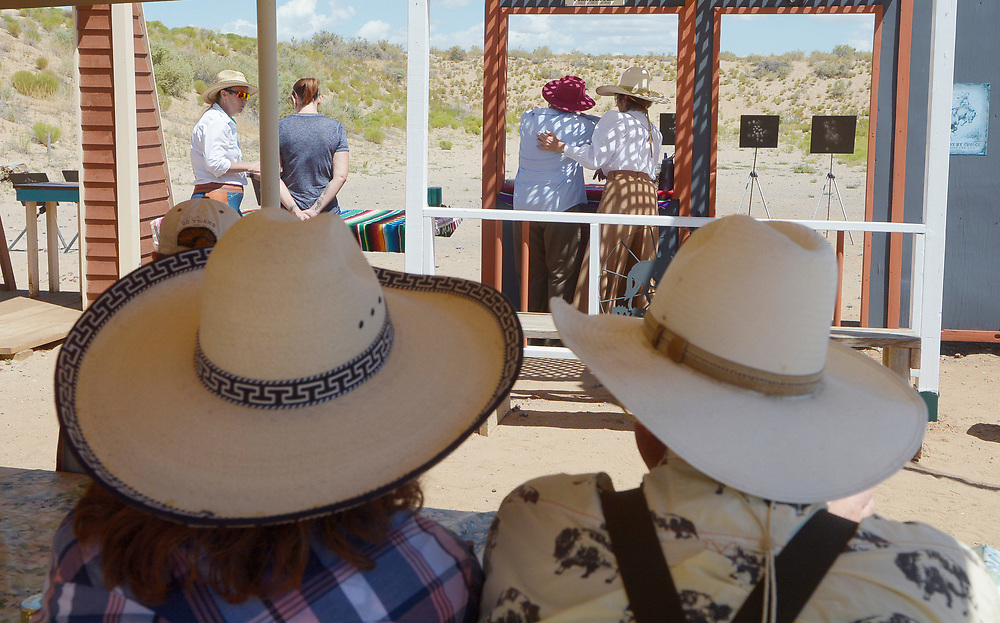 gbs072917o/RIO-WEST -- Gail Packard, left, and her husband, Jerry Packard, of Santa Fe watch the firing line during the Rio Grande Renegades Ladies Shoot  at the Albuquerque Shooting Range on Saturday, July 29, 2017. The Rio Grande Renegades, a Single Action Shooting Society club,will have the 2017 Fall Fandango, a State Action Shooting Championship, on October 19-22. (Greg Sorber/Albuquerque Journal)