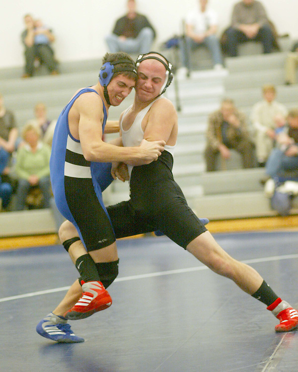 Panama's Derek Frye (L) and Maple Grove's Kraig Meekins battle in the 140lb match photo by Mark L. Anderson