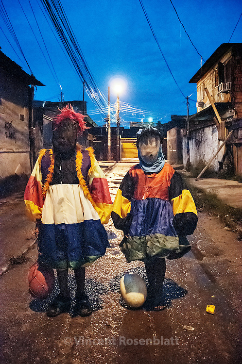 Kids from the favela of City of God love to fantasy as Bate Bola clowns. Still too young to get out and circulate out of the favela, they show in their neighboorhood..