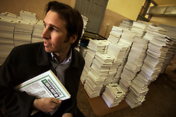 Jack Roe, of Balloch & Roe Services, is seen at the printing shop where he had their financial gazette printed in English and Arabic, in Baghdad, Iraq, Feb. 7, 2004. Roe, and his partner Brent Balloch, have made significant money in the reconstruction of Iraq. Among many projects, the entrepreneurs provide decals for new police cars in the country.