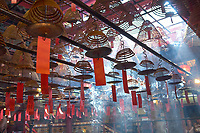 Incense coils burning in the Man Mo Temple or Man Mo Miu, on Hollywood Road, dedicated to the God of Literature, Man Tai, and the God of war, Mo Tai, Hong Kong, Hong Kong, August 2008   Photo: Peter Llewellyn