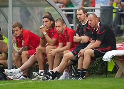 ZUG, SWITZERLAND - Wednesday, July 21, 2010: Liverpool's Joe Cole sits with team-mates Sotirios Kyrgiakos and goalkeeper Martin Hansen during the Reds' first preseason match of the 2010/2011 season against Grasshopper Club Zurich at the Herti Stadium. (Pic by David Rawcliffe/Propaganda)
