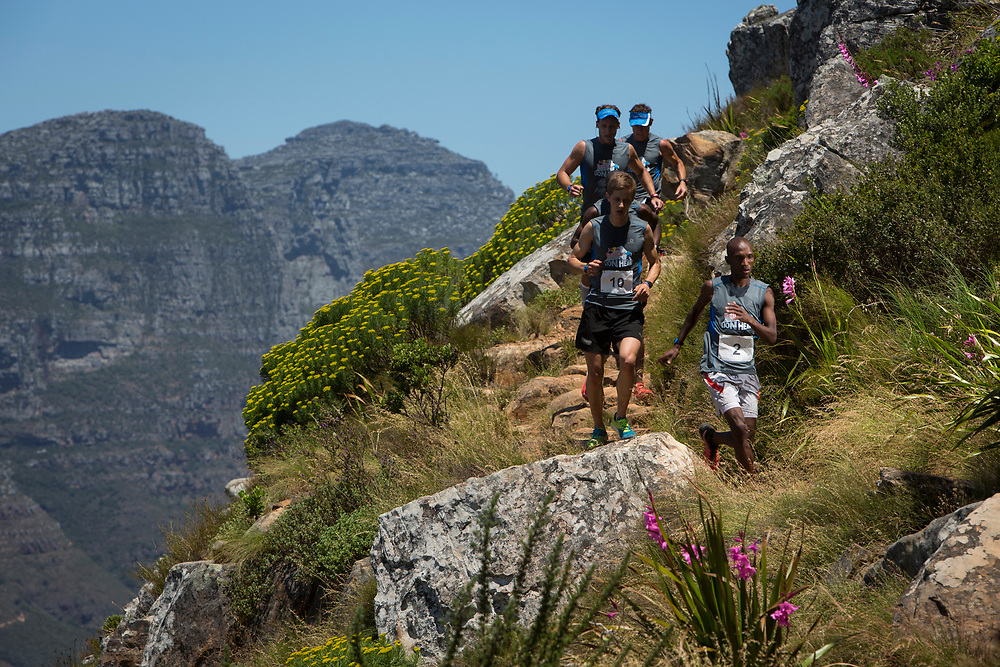 Thabang Madiba leads the chasing pack during the Red Bull Lion Heart, on Lions Head, Cape Town, South Africa, 9 November 2013