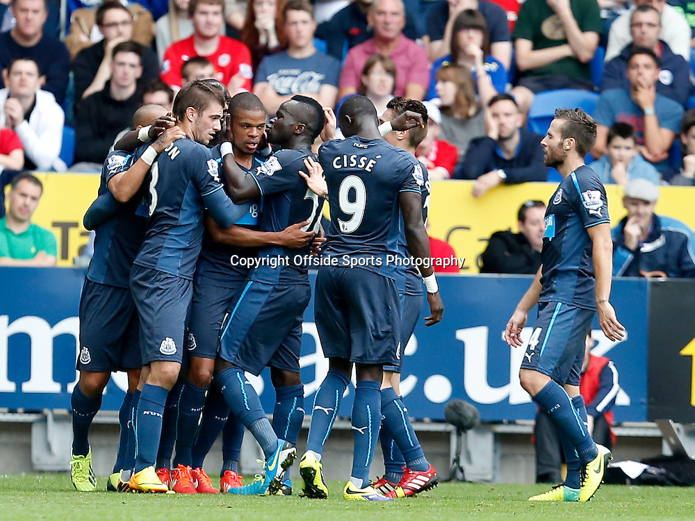 5th October 2013- Barclays Premier League - Cardiff City Vs Newcastle United - Cheick Tiote kisses Loic Remy of Newcastle United after the striker grabs his second goal for Newcastle (0-2) - Photo: Paul Roberts / Offside.