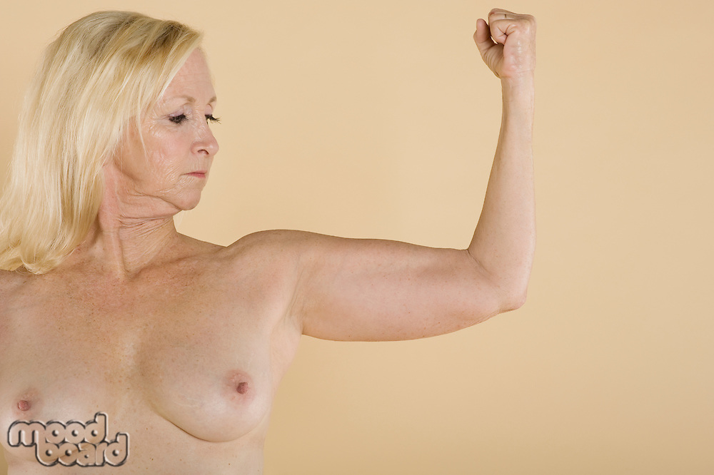 Naked woman flexing her muscles