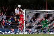 Keith Lowe gets beaten in the air during the Capital One Cup match between York City and Bradford City at Bootham Crescent, York, England on 11 August 2015. Photo by Simon Davies.