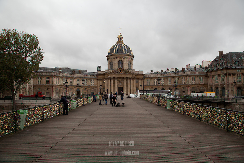 On one end of the Pont des Arts is the  Institut de France, on the other is the Louvre. Countless locks have been attached to the bridge by couples  expressing their love.