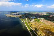 Nederland, Zeeland, Oosterschelde, 09-05-2013; Binnendijkse inlagen ten zuiden van Serooskerke. Landinwaarts zijn polders onder water gezet in het kader van Plan Tuureluur. Links de Oosterschelde. Nationaal park De Oosterschelde<br /> Land between the inner (original) dike and the sea dike near Serooskerke. Inland polders are inundated under the nature development project Tureluur. Oosterschelde left.<br /> luchtfoto (toeslag op standard tarieven);<br /> aerial photo (additional fee required);<br /> copyright foto/photo Siebe Swart.