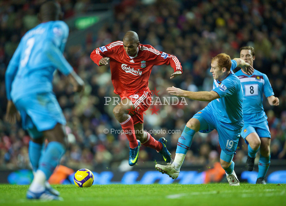 LIVERPOOL, ENGLAND - Monday, December 1, 2008: Liverpool's Ryan Babel and West Ham United's James Collins during the Premiership match at Anfield. (Photo by David Rawcliffe/Propaganda)