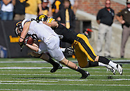 September 29 2012: Minnesota Golden Gophers wide receiver Derrick Engel (18) pulls in a pass as Iowa Hawkeyes linebacker Tom Donatell (13) defends during the first quarter of the NCAA football game between the Minnesota Golden Gophers and the Iowa Hawkeyes at Kinnick Stadium in Iowa City, Iowa on Saturday September 29, 2012. Iowa defeated Minnesota 31-13 to claim the Floyd of Rosedale Trophy.