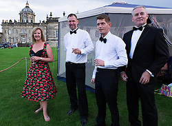 © Licensed to London News Pictures.22/08/15<br /> Castle Howard, North Yorkshire, UK. <br /> <br /> A group of friends from Newcastle dress up for the occasion as hundreds of people attend the 25th anniversary of the Castle Howard Proms event near York. The theme of the event this year is a commemoration of the 75th anniversary of the Battle of Britain and the 70th anniversary of VE day and brings an evening of classic musical favourites celebrating Britishness to the lawns of Castle Howard.<br /> <br /> Photo credit : Ian Forsyth/LNP