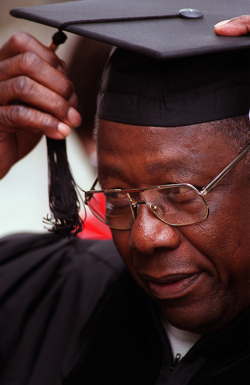 Baseball legend Hank Aaron adjusts his mortarboard before the start of Dartmouth College's commencement in Hanover, N.H., on Sunday, June 11, 2000. The Hall of Fame player received an honorary degree -- Doctor of Humane Letters -- from the Ivy League school. Aaron is now Senior Vice President of the Atlanta Braves. (Photo by Geoff Hansen)