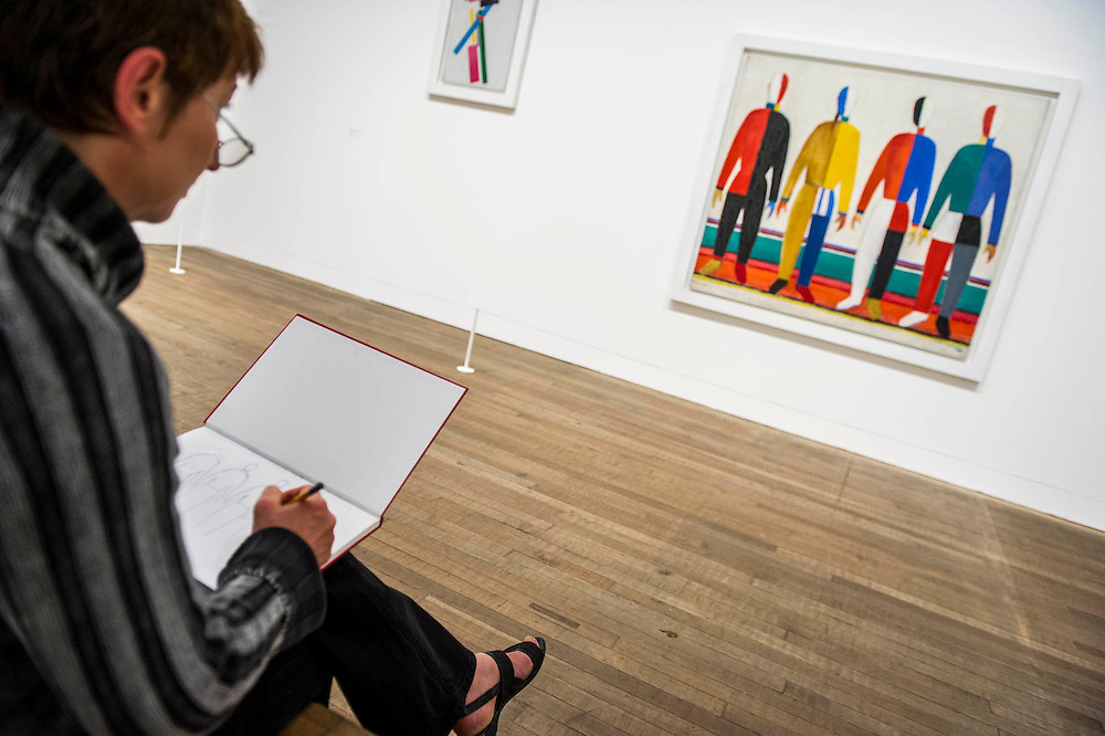 Tate Modern's new exhibition, of the avant-garde work of Russian Kazimir Malevich. Here Sportsmen. Tate Modern, Bankside, London, UK.