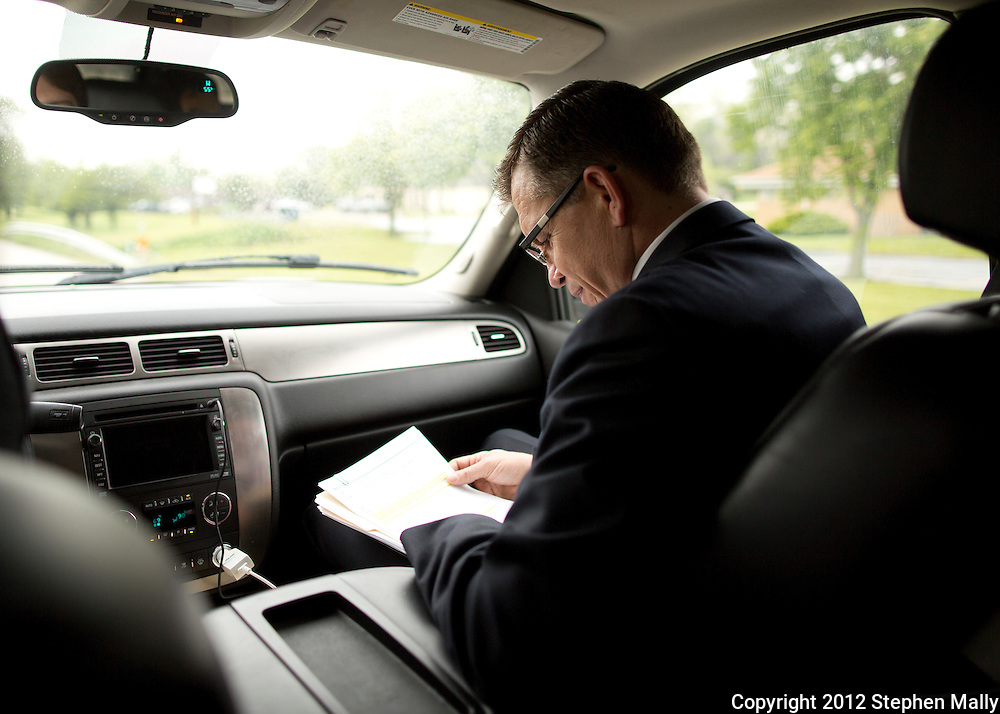 Rep. Bobby Schilling (R-Ill) looks over some notes in the car on the way to his next event in Moline, Illinois on Monday, April 30, 2012.
