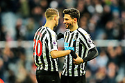 Fabian Schar (#5) of Newcastle United celebrates with Florian Lejeune (#20) of Newcastle United following Newcastle United's 3-2 victory during the Premier League match between Newcastle United and Everton at St. James's Park, Newcastle, England on 9 March 2019.
