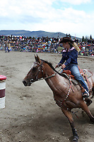 Woman riding horse in the barrel race at Te Anau rodeo.
