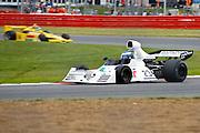 Car No 23 heads around Luffield. Silverstone Classic - 66-85 F1- 25/7/10.