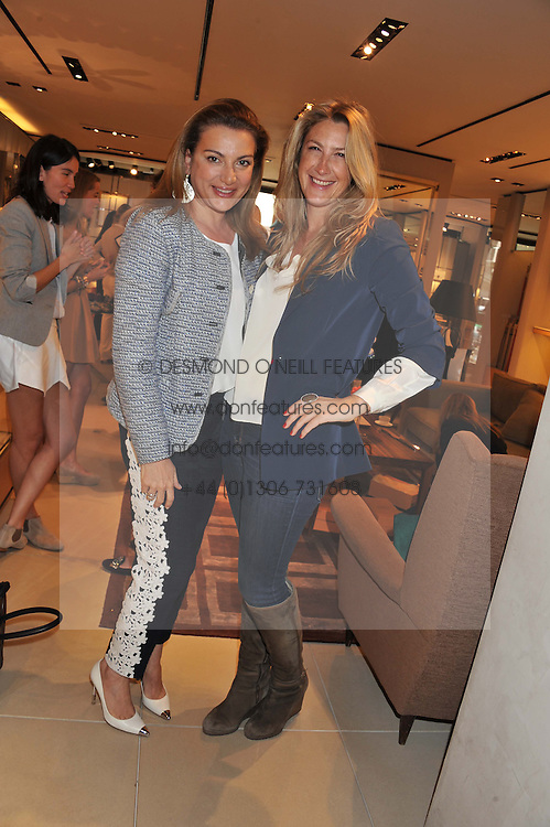 Left to right, EMMA ASKALI and GEORGINA COHEN at a champagne breakfast hosted by Carolina Gonzalez-Bunster and TOD's in aid of the Walkabout Foundation held at TOD's, 2-5 Old Bond Street, London on 9th May 2013.