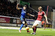 Swindon Town defender Raphael Rossi Branco (29) battles for possession with Northampton Town striker (on loan from Portsmouth) Michael Smith (24) during the EFL Sky Bet League 1 match between Northampton Town and Swindon Town at Sixfields Stadium, Northampton, England on 14 February 2017. Photo by Dennis Goodwin.