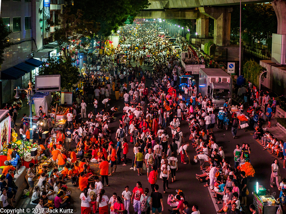 30 SEPTEMBER 2017 - BANGKOK, THAILAND:  The crowd at the Navratri parade in Bangkok. Navratri is a nine night (10 day) long Hindu celebration that marks the end of the monsoon and honors of the divine feminine Devi (Durga). The festival is celebrated differently in different parts of India, but the common theme is the battle and victory of Good over Evil based on a regionally famous epic or legend such as the Ramayana or the Devi Mahatmya. Navratri is celebrated throughout Southeast Asia in communities that have large Hindu population. Bangkok's celebration of Navratri was subdued this year because Thais are still mourning the death of Bhumibol Adulyadej, the Late King of Thailand, who died on October 13, 2016.     PHOTO BY JACK KURTZ