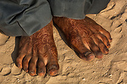Rajasthani village groom's feet 3 days after his wedding still with henna painted hands. Pushkar, Rajasthan. INDIA