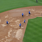 Ground staff treating the infield between innings during rain in the New York Mets Vs Cincinnati Reds MLB regular season baseball game at Citi Field, Queens, New York. USA. 27th June 2015. Photo Tim Clayton