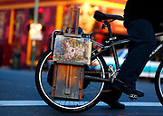 After making an oil painting of a memorial for the 36 victims of the Ghost Ship warehouse fire, artist John Paul Marcelo of Oakland, California  heads home on his bicycle.