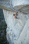 "Belayed by Tommy Caldwell, Alex Honnold makes the second free ascent of the crux roof pitch of ""Wet Lycra Nightmare"" (13d) on Leaning Tower, Yosemite N.P."