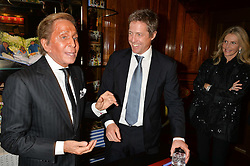 Left to right, VALENTINO GARAVANI and HUGH GRANT at a party to celebrate the launch of the Maison Assouline Flagship Store at 196a Piccadilly, London on 28th October 2014.  During the evening Valentino signed copies of his new book - At The Emperor's Table.