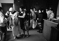 """Actors at St. Jerome Catholic Parish in Chicago care for 27 year old Juan Ponce (L) after his depiction of Jesus Christ during a Good Friday Via Crucis, the biblical account of Christ being condemned to death. The demanding task required Ponce to carry a full size cross 1.5 miles through the streets of Rogers Park, enduring rain and chill, then remaining """"hung"""" on the cross for for over 20 minutes with arms outstretched."""
