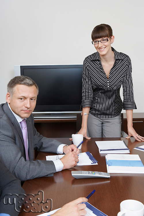 Business man and woman at desk in office