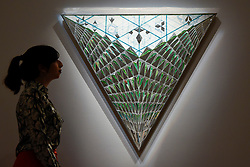 """© Licensed to London News Pictures. 21/04/2017. London, UK.  A staff member views """"Triangle of Hope"""", 2008, by Monir Farmanfarmaian, (est. GBP 100-200k), at a preview at Sotheby's, New Bond Street, of upcoming sales of Arts of the Islamic World, 20th century Middle East Art and Orientalist art. Photo credit : Stephen Chung/LNP"""