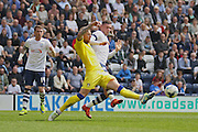 Prestons Alan Browne challenged during the Sky Bet Championship match between Preston North End and Leeds United at Deepdale, Preston, England on 7 May 2016. Photo by Pete Burns.